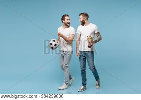 Excited Young Men Guys Friends In White T-shirt Isolated On Pastel Blue Background. Sport Leisure Co