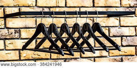 Wood Hangers Coat. Store Concept, Sale, Design, Empty Hangers. Fashionable Different Types Of Hanger