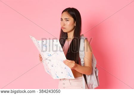 Travelling, Lifestyle And Tourism Concept. Portrait Of Troubled And Confused Cute Sulking Asian Girl