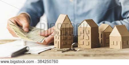 Saving Money To Buy A House. Investing Money In Real Estate, Rental Income.