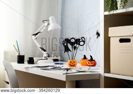Preparing For Halloween. Diy Concept. Halloween Decorations On A White Desk, Indoors. Daytime. Copy