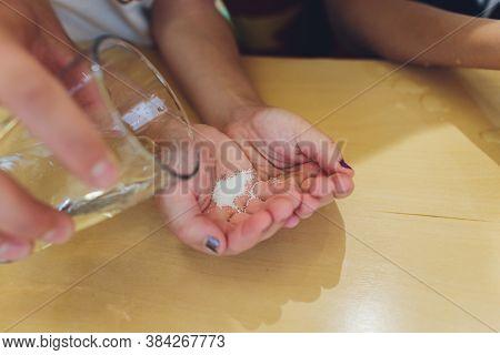 Hand Holding White Polystyrene Foam Beads Ball Drop From Styrofoam Machine For Fragile Stuff Packagi