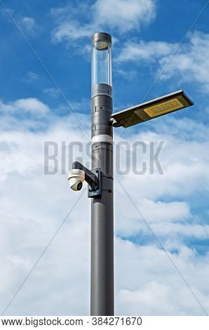 Lamppost With Led Lamp And Cctv Camera Against A Cloudy Sky On Sunny Spring Day
