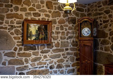 Old Stone House With Vintage Antique Clock, Decorative Lamp And Picture On The Wall. Antique Concept