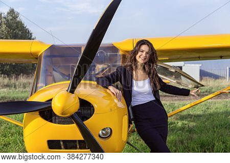 Ultralight Airplane And Laughing Brunette. Copy Space