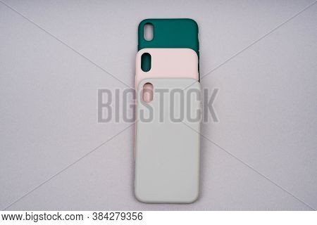 Three Silicone Cases For A Smartphone. Covers Of Gray, Green And Powder Color. A Set Of Three Covers