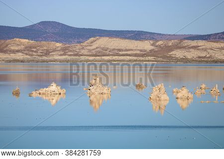Tufa Spires Which Are Salt Formations On Mono Lake, Ca Surrounded By Arid Desert Terrain
