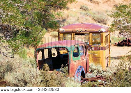 September 5, 2020 In Virginia City, Nv:  Abandoned Vintage Classic Car And School Bus Taken At An Ar