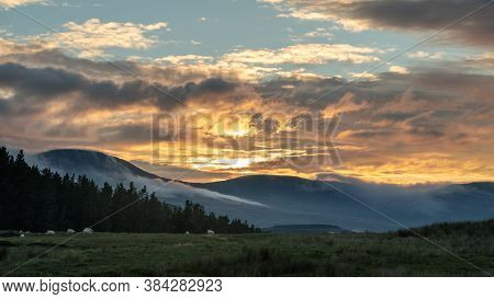 Panoramic View Of The Trotternish Ridge On The Isle Of Skye, Scotland. Beautiful Sunset Over Mountai