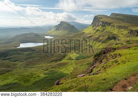 Scenic View Of Rock Formations In Quiraing, Isle Of Skye, Scotland. Beautiful Area Of Grassy Mountai