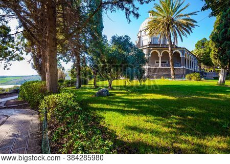 Blooming huge park around the monastery. The Catholic Church of the Beatitudes of the Italian female Franciscan monastery on Mount Bliss. The Sea of Galilee. Israel.  concept of religious pilgrimage