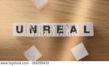 Wooden Cubes With Word Unreal. Facts And Figusres True And Lies Concept