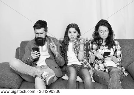 Smartphone Ruining Relations. Unhappy Child Complain Of Parents Addicted To Phones. Parents And Chil