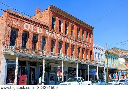September 5, 2020 In Virginia City, Nv:  Boardwalk Underneath Historical Brick Buildings With Hotel