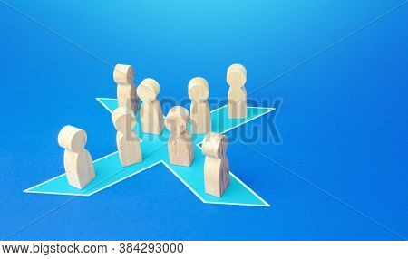 People Stand In Shape Of A Blue X. Combining Forces To Successfully Solve The Problem. Social Tensio