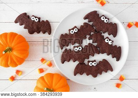 Halloween Bat Cookies, Above View With Pumpkins On A White Wood Background