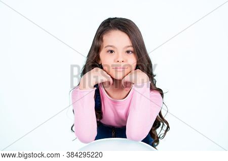 Child Model Smiling With Long Brunette Hair, Hairstyle. Little Girl Smile With Young Face Skin, Skin