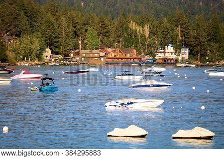 September 4, 2020 In Lake Tahoe, Ca:  Anchored Boats And Jet Skis On The Shore Of Lake Tahoe, Ca Whe