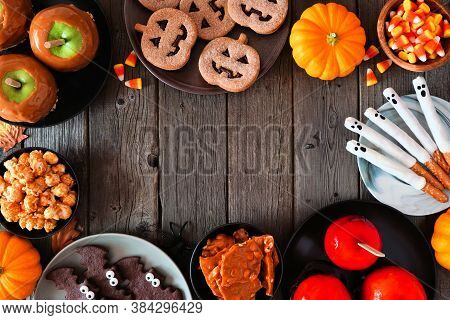 Rustic Halloween Treat Frame Over A Dark Wood Background With Copy Space. Overhead View. Selection O