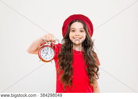 Shopping, Sales And Time Concept. Parisian Child On Yellow. Child With Alarm Clock. Timeless Fashion