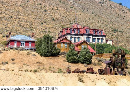 Historical Buildings Including A Vintage Hotel And Homes On An Arid Hillside Overlooking The Communi