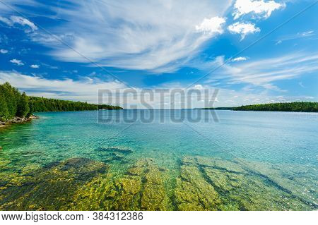 Amazing Natural Inviting Landscape View Of Bruce Peninsula Park At Lake Huron With Crystal Clear Tur