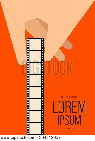 Movie And Film Poster Design Template Background With Human Hand Holding Filmstrip. Can Be Used For