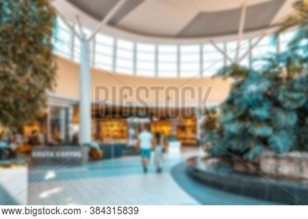 Shopping Center Blurred Background. People Shopping In Modern Commercial Mall Center. Interior Of Re