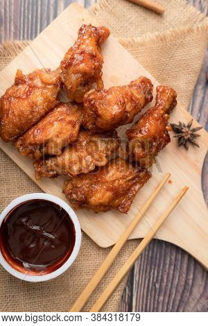 Hot And Spicy Korean Barbeque Fried Chicken On Wood Cutting Board Over Wooden Table Preparing For Me