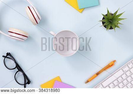 Center Coffee Cup And Office Supplies As Keyboard,headphone,pen,sticky Note,office Plants,glasses On
