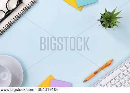 Modern Clean Office Desk Or Office Table On Top View And Stationery As Keyboard Spiral Notebook Pen