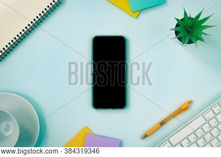 Vertical Mobile Phone Or Smartphone And Office Supplies As Keyboard Pen Stick Note Office Plants Spi