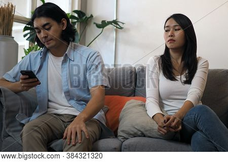 The Wife Suspects That Her Husband Is Unfaithful. Secretly Chat With Other Girls. Infidelity And Lov