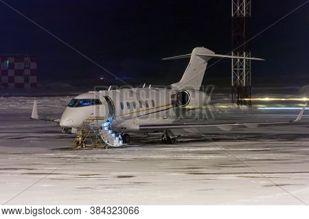 Private Jet Plane At Night Airport Apron