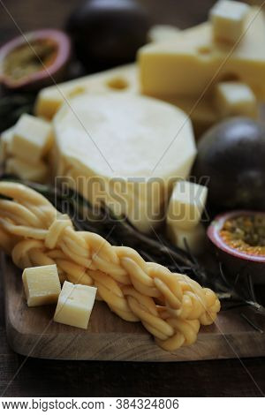 Cheese Platter With Fruits And Herbs.soft And Hard Cheeses Set, Passion Fruit , Rosemary On Dark And