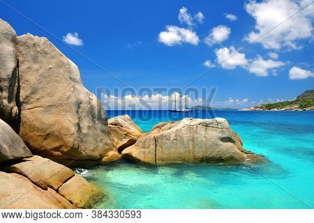 Big granite stones on the tropical beach, Coco Island, Indian ocean, Seychelles. Exotic destinations.
