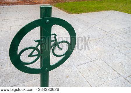 Sidewalk Steel Bike Locking Pole Painted Green With Bike Icon Symbol Metal Graphic