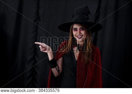 Portrait of asian young adult teenage woman wear Halloween costume cloth for Halloween party carnival. Halloween celebrate and international holiday concept.