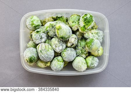 Frozen Brussels Sprouts In A Plastic Container For Long-term Storage. Deep Freezing Of Vegetables. F