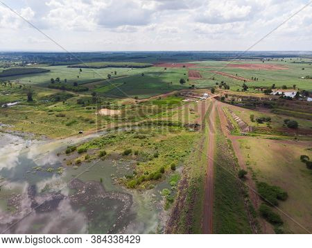 Drone Shot Aerial View Scenic Landscape Of River Reservoir Dam And The Forest