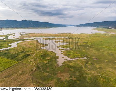 Scenic Landscape Aerial View Of Field River And Basin Against A Natural Mountain, Drone Shot Tropica