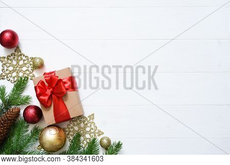 Christmas White Background With Fir, Gifts And Decor. Top View With Space For Copy.