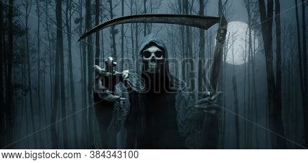 Grim Reaper Reaching Towards The Camera Over Dark, Foggy Background With Copy Space