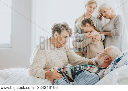 Worried Family Saying Goodbye To Sick Passing Grandfather