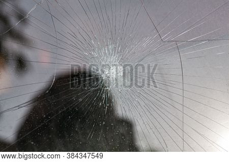 Broken Glass. Car Glass Cracked From An Accident. Armored Glass After Impact. Glass Reinforced With