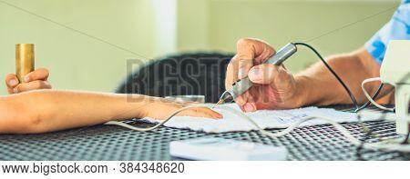 Vegetative Rezonans Diagnostic. Doctor Examines Child Boy Hand With The Help Of Bioresonance Dipstic