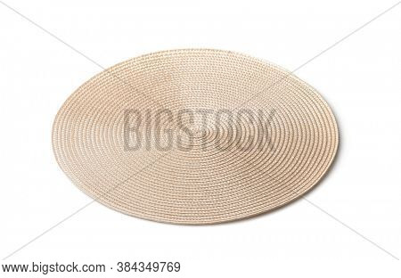 Round braided placemat isolated on white