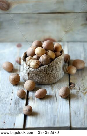 Selective Focus. Small Raw Potatoes In A Bag. Baby Potatoes. Rustic Style. Rustic Potatoes.