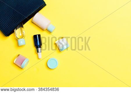 Woman Cosmetic Bag With Set Of Beauty Product And Bodycare Cream On Yellow Background With Copy Spac