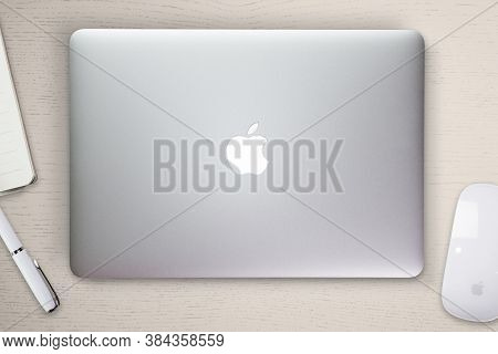 Apple Macbook Pro Retina Cover On A Desk, Table With Mouse And Stationery. Mockup For Decal, Sticker
